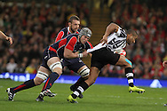 Dan Lydiate of Wales holds onto Fiji's Michael Tagicakibau (r). Invesco Perpetual series, Wales v Fiji , rugby international match at the Millennium Stadium in Cardiff on Friday 19th Nov 2010.  pic by Andrew Orchard, Andrew Orchard sports photography,