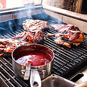 Barbecue chicken and ribs on the grill at the famous Uncle Joe's Barbecue in Cruz Bay on St. John in the US Virgin Islands.