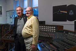 Bonhams, London, March 20th 2017. Pink Floyd drummer Nick Mason poses with former head of Abbey Road Studios sound engineer Ken Townsend (R) and the Abbey Road Studios EMI TG12345 MK IV recording console Pink Floyd used to record their landmark album, The Dark Side of the Moon, to be sold by Bonhams at their TCM Presents...Rock and Roll Through the Lens sale in New York on 27 March 2017.