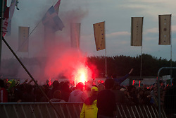 A flare in the crowd as The Strokes play at the Radio 1/NME Stage..T in the Park on Saturday 9th July 2011. T in the Park 2011 music festival takes place from 7-10th July 2011 in Balado, Fife, Scotland..©Pic : Michael Schofield.