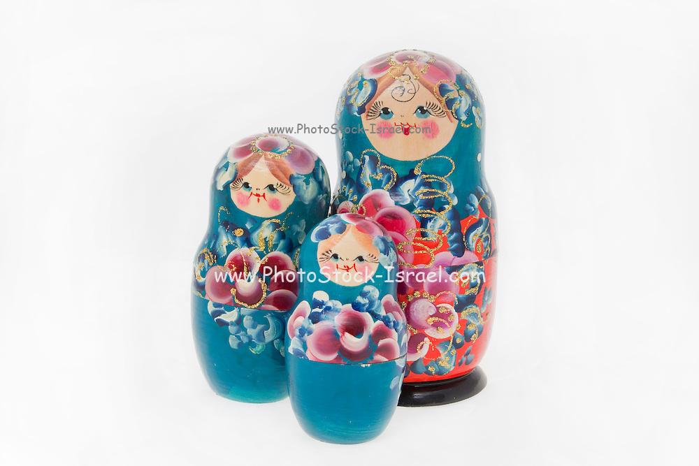 3 Matryoshka (Babushkah also Babooshka) dolls of different sizes on white background