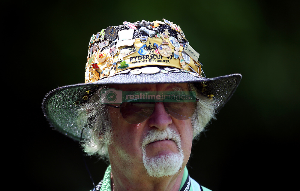 An official with golf themed pin badges on his hat during day one of the 2017 BMW PGA Championship at Wentworth Golf Club, Surrey.