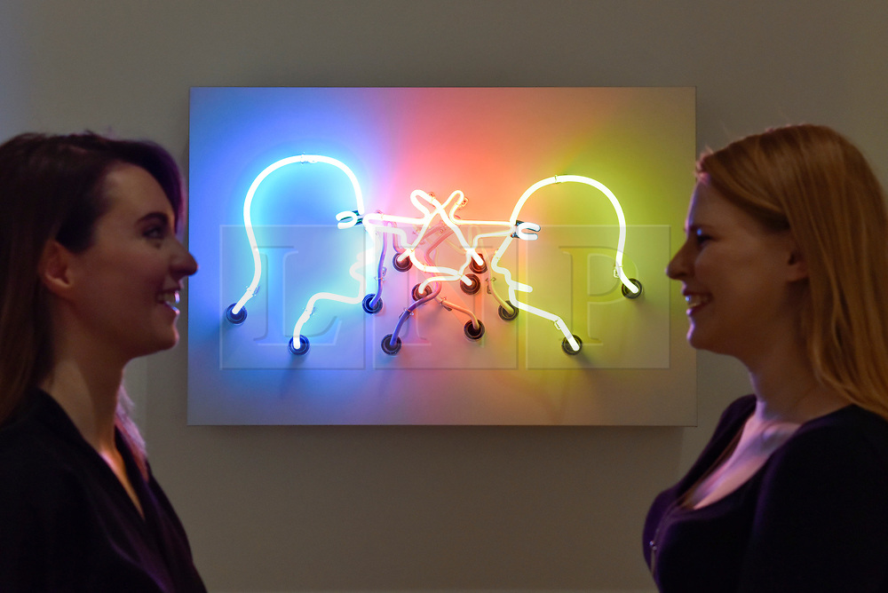 """© Licensed to London News Pictures. 31/07/2017. London, UK. Gallery staff members in front of """"Double Poke in the Eyes II"""", 1985, by Bruce Nauman.  Preview of the new Artist Rooms exhibition of Bruce Nauman at Tate Modern on currently until July 2018.  Nauman is widely regarded as one of the most innovative and influential American artists working today.  The Artist Rooms gallery is the London hub for showcasing work from the Artist Rooms collection which is owned jointly by Tate and the National Galleries of Scotland.  Photo credit : Stephen Chung/LNP"""