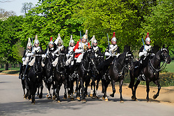 Mounted Household Cavalry soldiers on horseback in Hyde Park London United Kingdom