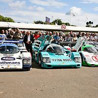 Rothmans works Porsche 956 008, Kremer Racing Leyton House Porsche 962 CK6, Joest Racing Porsche 962 011 lined up at Goodwood Festival of Speed 2008