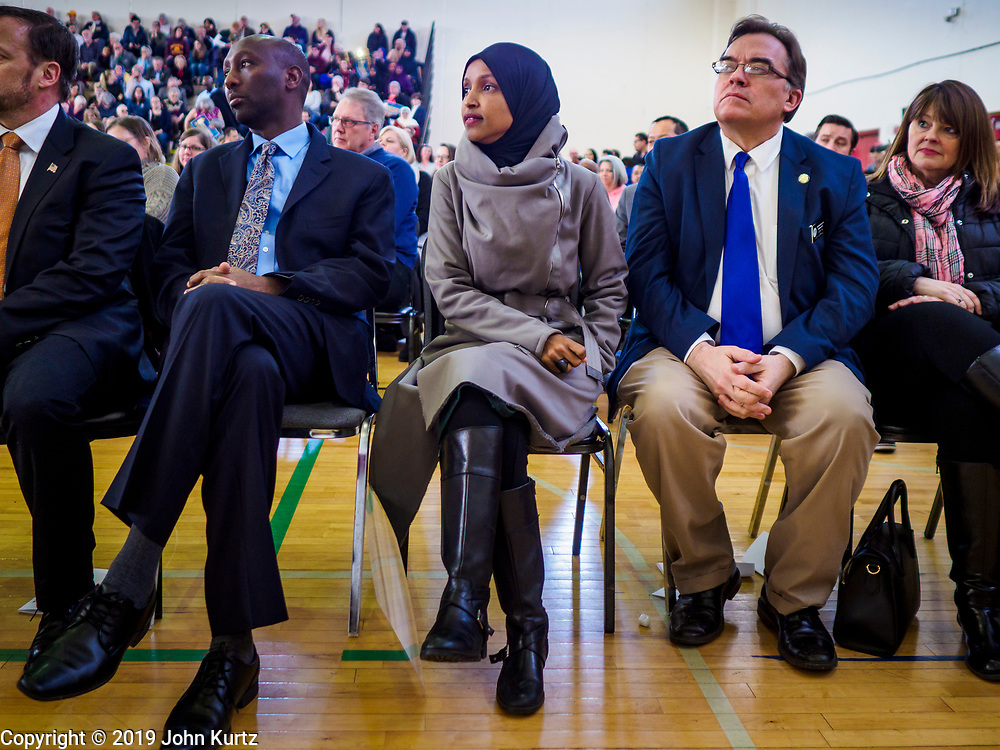 16 MARCH 2019 - BLOOMINGTON, MINNESOTA, USA: Congresswoman ILHAM OMAR (D-MN) (center) at Dar al Farooq Center in Bloomington. She is the first Somali-American elected to congress. An interdenominational crowd of about 1,000 people came to the center to protest white supremacy and religious intolerance and to support Muslims in New Zealand who were massacred by a white supremacist Friday. The Twin Cities has a large Muslim community following decades of Somali immigration to Minnesota. There are about 45,000 people of Somali descent in the Twin Cities.   PHOTO BY JACK KURTZ