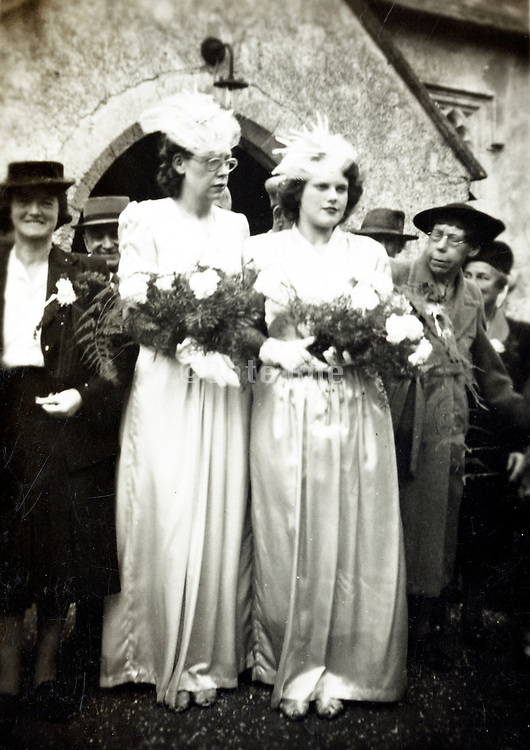 two brides in front of church 1930s England