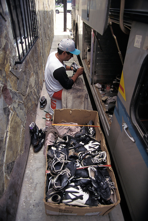 OAXACA, MEXICO: Money is a lot less in the Mexican Baseball League so shoes are polished and marked with pens to hide the blemishes.