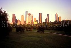 sun setting on the western side of the Houston skyline stock photo,stock,stock photography,stock image
