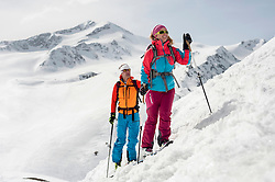 Man woman couple cross-country skiing Alps