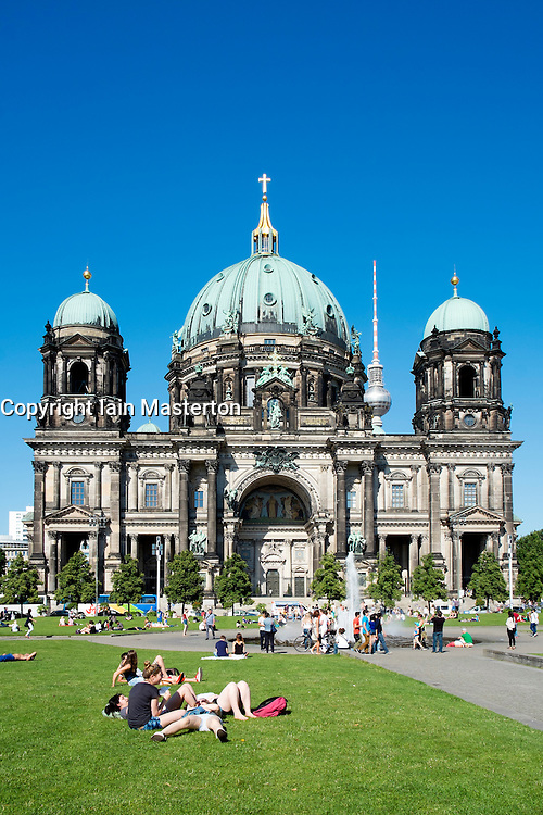 Crowds of people during summer in  Lustgarten in front of The Dom or Cathedral on Museumsinsel in Berlin Germany