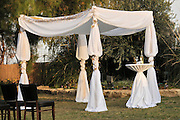 The Jewish wedding canopy, A chuppah (also spelled hupah, chupah, or chuppa) is a canopy traditionally used in Jewish weddings. It consists of a cloth or sheet, stretched or supported over four poles. A chuppah symbolizes the home the couple will build together.