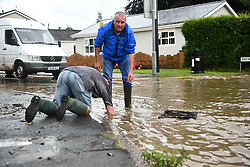 © Licensed to London News Pictures. 17/08/2020. City, UK. Emergency services and residents in Ystradgynlais in the Swansea Valley, Wales, battled flood water after flash flooding hit the area. Within a matter of minutes roads were blocked, with a car being abandoned and homes came under threat of being breached by the water as poor weather hit the UK on Monday. Photo credit: Robert Melen/LNP