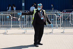 © Licensed to London News Pictures. 01/06/2020. London, UK. A security guard wearing PPE directs customers practicing social distancing queuing in a car park outside the reopened Ikea furniture store in Wembley. The company closed its UK stores in the UK on March 20 due to the Coronavirus lockdown. Customers will experience enhanced cleaning and safety precautions and social distancing rules will be enforced. Photo credit: Ray Tang/LNP