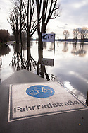 flood of the Rhine on February 5th. 2021, flooded bicycle street on the banks of the river Rhine in the district Poll, Cologne, Germany.<br /> <br /> Hochwasser des Rhein am 5. Februar 2021, ueberflutete Fahrradstrasse in den Rheinwiesen im Stadtteil Poll, Koeln, Deutschland.