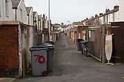 Wheelie bins down the back alley of two streets in the Bloomfield ward of Blackpool.  Lancashire. United Kingdom