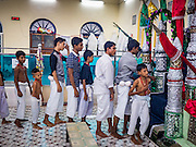 20 OCTOBER 2015 - YANGON, MYANMAR: Burmese Shia Muslims line up to pray at a shrine to Hussein ibn Ali at Punja Mosque in Yangon. Ashura commemorates the death of Hussein ibn Ali, the grandson of the Prophet Muhammed, in the 7th century. Hussein ibn Ali is considered by Shia Muslims to be the third imam and the rightful successor of Muhammed. He was killed at the Battle of Karbala in 610 CE on the 10th day of Muharram, the first month of the Islamic calendar. According to Myanmar government statistics, only about 4% of the population is Muslim. Many Muslims have fled Myanmar in recent years because of violence directed against Burmese Muslims by Buddhist nationalists.    PHOTO BY JACK KURTZ