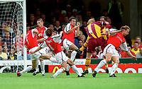 Stuart McCall (4)  shoots past Martin Keown, Frederik Ljungberg, Oleg Luzhny, Gilles Grimandi and Ray Parlour to score the Bradford goal. Bradford City 1:1 Arsenal, F.A. Carling Premiership, 9/9/2000. Credit Colorsport / Stuart MacFarlane.