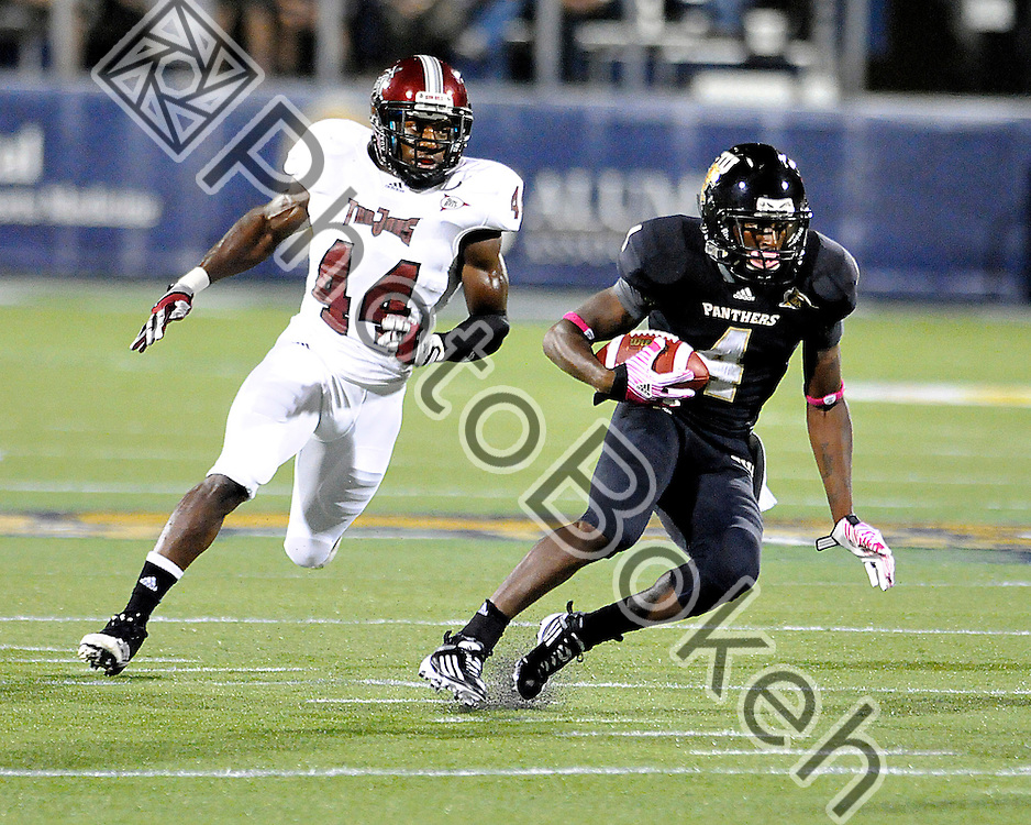2011 October 25 - Florida International wide receiver T.Y. Hilton (4) running the ball while Troy linebacker Kanorris Davis (44) chases. Florida International University Golden Panthers defeated the Trojans of Troy, 23-20 in overtime, at Alfonso Field, Miami, Florida. (Photo by: www.photobokeh.com / Alex J. Hernandez) 1/640 f/2.8 ISO3200 450mm