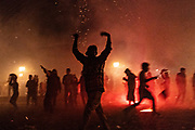 Young men run around as sky rockets explode during the Alborada festival September 29, 2018 in San Miguel de Allende, Mexico. The unusual festival celebrates the cities patron saint with a two hour-long firework battle at 4am representing the struggle between Saint Michael and Lucifer.