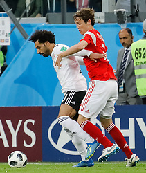 June 19, 2018 - Saint Petersburg, Russia - Mario Fernandes (R) of Russia national team and Mohamed Salah of Egypt national team vie for the ball during the 2018 FIFA World Cup Russia group A match between Russia and Egypt on June 19, 2018 at Saint Petersburg Stadium in Saint Petersburg, Russia. (Credit Image: © Mike Kireev/NurPhoto via ZUMA Press)