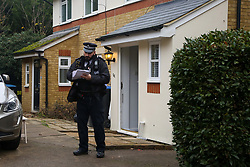 © Licensed to London News Pictures. 28/11/2020. London, UK. A police officer guards a residential property on Macleod Road in Enfield where a man in his 30s was stabbed to death. Police were called on Friday, 27 November and found a critically injured man, who had sustained a number of stab wounds. Police officers administered CPR prior to the arrival of the London Ambulance Service, however the man could not be revived. A man has been arrested at the location on suspicion of murder. Photo credit: Dinendra Haria/LNP