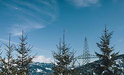 THEMENBILD - ein Strommast zwischen Nadelbäumen, aufgenommen am 27. Februar 2020 in Kaprun, Oesterreich // a power pole between coniferous trees, in Kaprun, Austria on 2020/02/27. EXPA Pictures © 2020, PhotoCredit: EXPA/Stefanie Oberhauser