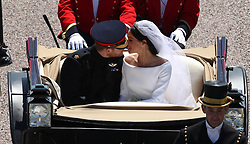 Prince Harry and Meghan Markle ride in an Ascot Landau along the Long Walk after their wedding in St George's Chapel in Windsor Castle.
