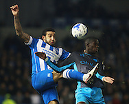 Brighton defender Connor Goldson & Sheffield Wednesday striker Lucas Joao compete for a high ball during the Sky Bet Championship match between Brighton and Hove Albion and Sheffield Wednesday at the American Express Community Stadium, Brighton and Hove, England on 8 March 2016. Photo by Bennett Dean.
