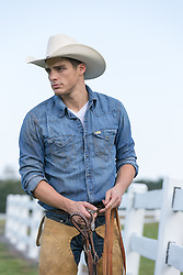 cowboy with a lasso on a ranch hot cowboy on a ranch