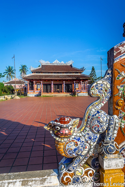 Easily walk to Confucius Temple to see and learn about the culture of Vietnam. Small colorful tile pieces make a mosaic of these serpents the protect the temple. RAW to Jpg