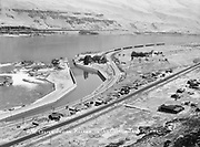 9305-B7025. Bird's-eye view of Celilo from the rimrock above the village, about 1930. The recently-built Shell station on the east end of town is the Tumwater Auto Service Station, owned by the Seufert brothers. on the lower right is the Celilo general store. That general area is where the present Celilo Village and longhouse are located.