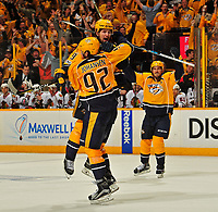 NASHVILLE, TN - APRIL 17:  Filip Forsberg #9 of the Nashville Predators jumps into the arms of teammate Ryan Johansen #92 after scoring the game tying goal against the Chicago Blackhawks during the third period in Game Three of the Western Conference First Round during the 2017 NHL Stanley Cup Playoffs at Bridgestone Arena on April 17, 2017 in Nashville, Tennessee.  (Photo by Frederick Breedon/Getty Images)