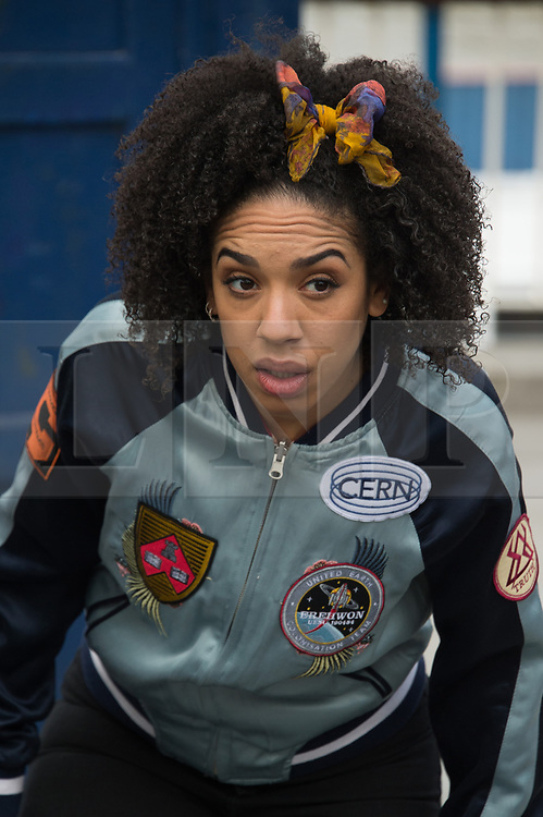 Actress Pearl Mackie who plays new companion Bill Potts stands on 3D Alien Landscape painting to celebrate new TV series of Dr Who.