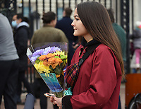 Floral Tributes For Prince Philip<br /> Members of the public  leaving floral tributes for  Prince Philip outside Buckingham Palace in London photo by Krisztian Elek