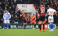 Bournemouth's Marc Pugh (centre) celebrates scoring his side's first goal of the game during the Emirates FA Cup, third round match at the Vitality Stadium, Bournemouth.