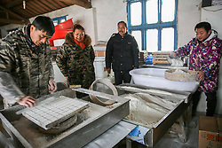 February 5, 2018 - Rugao, Rugao, China - Rugao,CHINA-5th February 2018: People make sticky rice cake in Rugao, east China's Jiangsu Province. It's a tradition to make and eat steamed glutinous rice cake during Spring Festival in China. (Credit Image: © SIPA Asia via ZUMA Wire)
