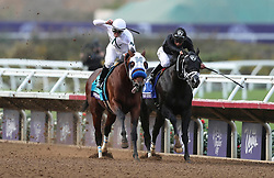 November 3, 2017 - Del Mar, California, U.S. - Battle of Midway, left, with jockey FLAVIEN PRAT edges out Sharp Azteca with jockey PACO LOPEZ to win the seventh race during the Breeders' Cup at the Del Mar racetrack in Del Mar on Friday. (Credit Image: © Hayne Palmour Iv/San Diego Union-Tribune via ZUMA Wire)