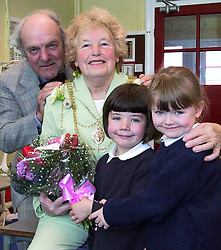 Carcroft Primary school pupils Sophie Cooper and Kayleigh Barton present flowers and a card to the Mayor of Doncaster Cllr Beryl Roberts and her husband Joe to mark thier 50th Wedding annivbersary Pupil Amberly Lesterman open the Early Learning centre at Carcroft Primary school<br /><br /><br />Thursday 28 Feb 2002