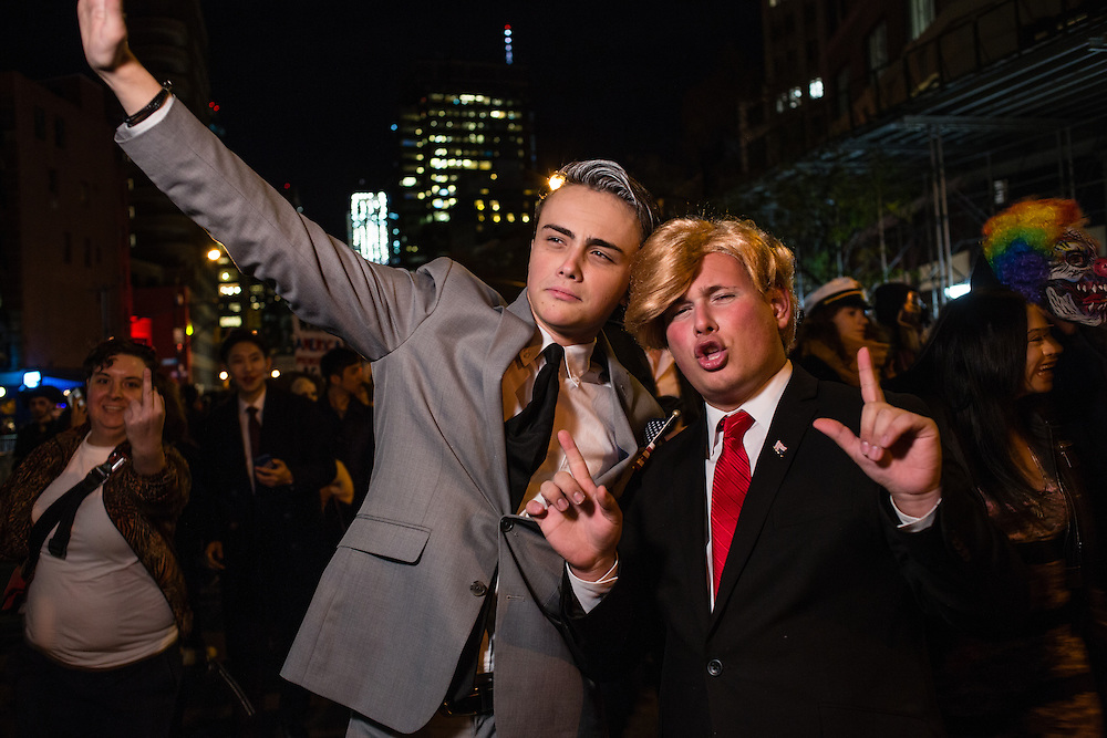 New York, NY - 31 October 2016. Two men costumed as Mike Pence and Donald Trump march in the annual Greenwich Village Halloween parade.
