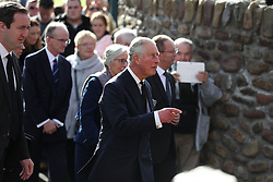 The Prince of Wales (centre) arrives for a visit to the Aberfan Memorial Garden in Wales, on the 50th anniversary of the Aberfan disaster.