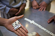 Prisoners play dominoes and socialise during association on C wing at YOI Aylesbury, Buckinghamshire, United Kingdom. HMYOI / HM Prison Aylesbury (Her Majesty's Young Offender Institution Aylesbury) is a prison is operated by Her Majesty's Prison Service.