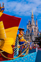 Sheriff Woody and other Disney characters on parade near the Cinderella Castle in the Magic Kingdom, Walt Disney World, Orlando, Florida USA
