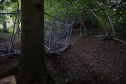 Kenilworth, UK. 24th August, 2020. Fencing around a badger sett close to HS2 works in Crackley Woods. Anti-HS2 activists continue to protest against and attempt to prevent or delay works in connection with the controversial HS2 high-speed rail link from a series of camps along the Phase One route from Euston to north of Birmingham.