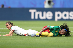 England's Jill Scott (left) tackles Cameroon's Yvonne Patrice Leuko during the FIFA Women's World Cup, round of Sixteen match at State du Hainaut, Valenciennes.