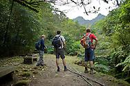 Trekkers survey the mountains as they begin a hike up Fengtoujian, near Taipei, Taiwan.