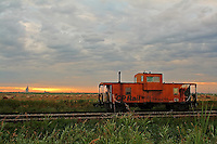 This old beauty is parked on the tracks near the plant I work at and it seems to draw me in all the time.  This morning I arrived in time to see the sun poking up under the cloudbank behind and it created the most amazing cloud patterns, so of course I had to shoot it again!<br /> <br /> ©2007, Sean Phillips<br /> http://www.Sean-Phillips.com