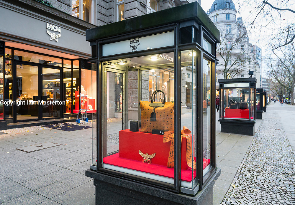 Glass display cabinet for luxury boutique MCM on famous shopping street Kurfurstendamm , Kudamm, in Berlin, Germany.