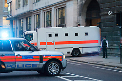 © London News Pictures. 26/02/2014. London, UK.  A police led convoy of two prison vans carrying Michael Adebolajo and Michael Adebowale leaving the old bailey where they were sentenced to a whole-life term &  45 years in prison respectively for the murder of Fusilier Lee Rigby who was attacked near Woolwich Barracks in south-east London on May 22, 2013. Photo credit: Hugo Michiels/LNP