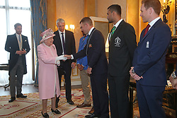 Queen Elizabeth II meets Australia cricket captain Aaron Finch (second left), Afghanistan captain Gulbadin Naib (left), Bangladesh captain Masrafe Bin Mortaza (third left), and England captain Eoin Morgan (right). The captains of the teams taking part in the ICC Cricket World Cup meet for a photograph in the 1844 Room at Buckingham Palace in London, ahead of the competition's Opening Party on the Mall.